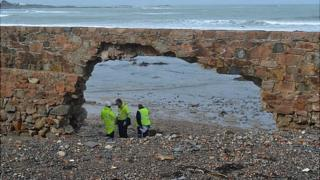 Arch created in the Vazon sea wall by winter storms