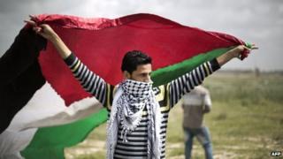 Man waving Palestinian flag