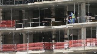 Migrant workers on a World Cup 2022 infrastructure building site in Doha