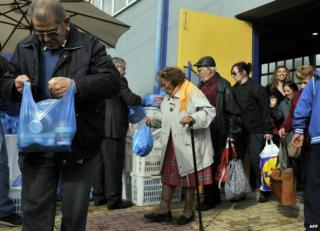 Free food handout for poor people in Athens - file pic