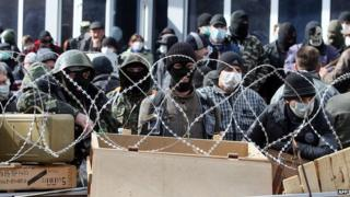 Pro-Russian activists guard a barricade set at the Ukrainian regional Security Service building on the eastern city of DonetskPro-Russian activists guard a barricade set at the Ukrainian regional Security Service building on the eastern city of Donetsk