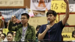 Lin Fei-fan, left, and Chen Wei-ting, leaders of the student protests against a trade pact with China, speak to the media during a press conference on the occupied legislature floor in Taipei, Taiwan, Monday, April 7, 2014.