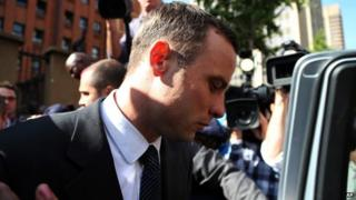 Oscar Pistorius leaves the high court in Pretoria, South Africa, on Tuesday (8 April)