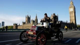 A car drives over Westminster Bridge