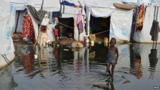 A child in a flooded area at a UN camp in Juba, South Sudan (2014)