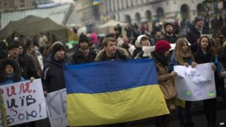 Protesters in Kiev fly Ukraine's flag as they demonstrate against Russia's interference in the country - 1 March 2014