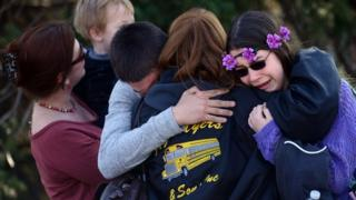 Family members hug in Murrysville, Pennsylvania following a knife attack at a local high school.