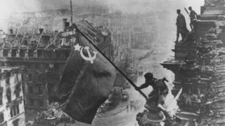 The iconic image of a Red Army soldier on top of the Reichstag in 1945