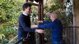 Ed Miliband is greeted by the outstretched arms of his mother's cousin Sara