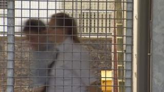 Marcin Kostrzewa and custody guard