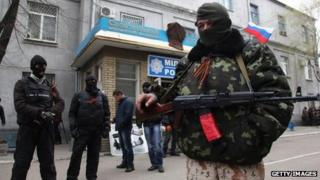 Pro-Russian activists guard police station in the eastern Ukrainian city of Slavyansk