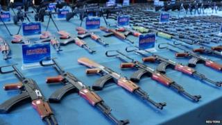 This picture taken on 1 April 2014 shows guns confiscated by police in Guiyang, southwest China's Guizhou province