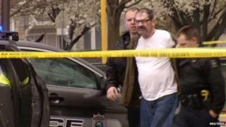 Screenshot from video of Frazier Glenn Cross, 73, of Aurora, Missouri, being led to a police car in Overland Park, 13 April 2014