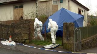 Forensic experts at the property in Largs