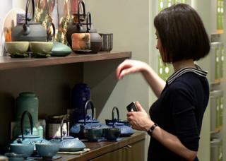 Woman serves tea