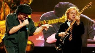 AC/DC's frontman Brian Johnson, left, and guitarist Angus Young perform at New York's Madison Square Garden in 2001