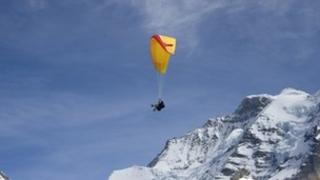 A paraglider over mountains