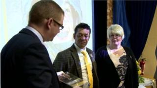 Simon Hamilton presented a plaque to Channing's parents