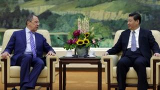 Sergei Lavrov (left) discussed the crisis in Ukraine with Xi Jinping