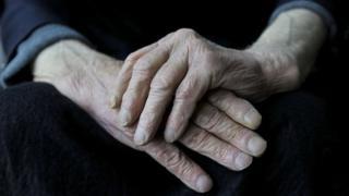 Hands of elderly person