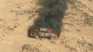 Pick-up truck attacked and destroyed by Jordanian warplanes on the Jordan-Syria border (16 April 2014)