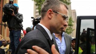 Oscar Pistorius leaves the high court in Pretoria (17 April 2014)