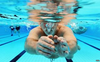 Man swims in swimming pool in Karlsruhe, southern Germany