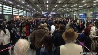 Queues of people at St Pancras Station