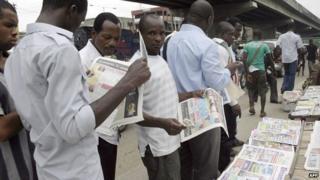People reading newspapers in Nigeria - 2010