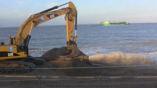 Flood clean-up work on the Lincolnshire coast