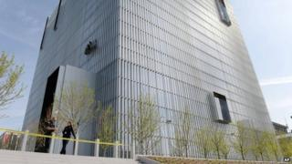 Authorities secure the plaza as police investigate a shooting inside the Federal Courthouse in Salt Lake City 21 April 2014
