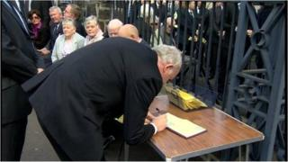 Deputy First Minister Martin McGuinness signs a Book of Condolence for Mr McClarty