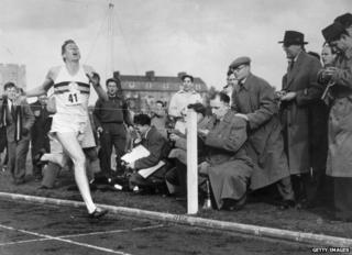 Roger Bannister about to cross the tape at the end of his record breaking mile run at Iffley Road, Oxford