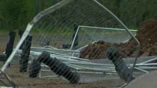 Security fencing on the construction site was knocked down