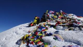 (FILES) In this photograph taken on May 23, 2013, unidentified mountaineers look out from the summit of Mount Everest.