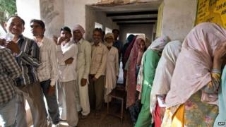 Indian residents queue to cast their votes at a polling booth in Hasanpur in Alwar, Rajasthan on April 24, 2014.
