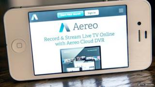 A smartphone displays the Aereo app.