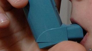Child using blue inhaler