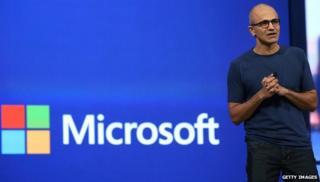 Satya Nadella and Microsoft logo