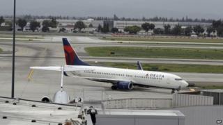 A plane taxis after landing at Mineta San Jose International Airport, 21 April 2014