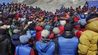 This April 24, 2014 photo released by Adrian Ballinger, founder and head guide of Alpenglow Expeditions, shows a meeting between Nepalese government delegation and Sherpa mountain guides near Everest base camp