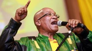 South African President t Jacob Zuma leads hundreds of supporters in singing a song during a campaign event at the Inter-fellowship Church in Wentworth township, outside of Durban, on 9 April 2014