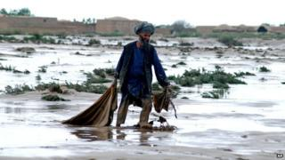 Man in Afghan flood area