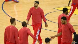 Los Angeles Clippers players warm up with shirts on inside out