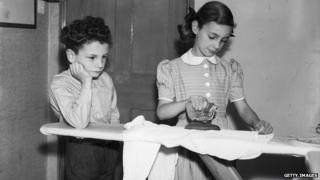 Children ironing