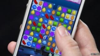 Woman playing Candy Crush