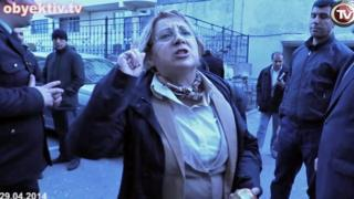 Leyla Yunus rebukes police outside her home following her arrest