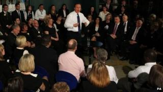 David Cameron answer questions from employees of John Lewis in Greater Manchester last month
