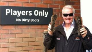 Rodney Marsh holding boot brushes