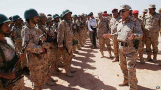Yemeni Defence Minister Mohammad Nasser Ahmad, right, talks to troops at a military site in the southern province of Shabwa, Yemen, 28 April 2014